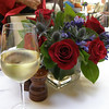 Flowers(roses, agapanthus, thistle) and riesling