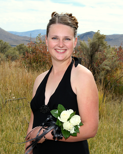 BLAINE FALKENA -- Adrienne poses at Erin's wedding in Idaho on September 28th with the mountains of Idaho and Utah in the background.