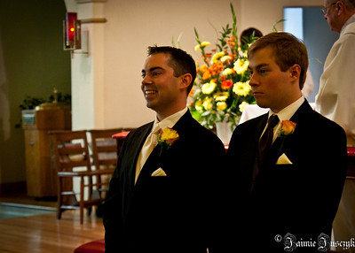 Mike's reaction when he saw Jess coming up the aisle.