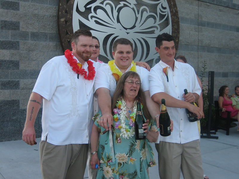 I don't know what Grant is doing with his arms, But Miles' mom and the boys...well some of them