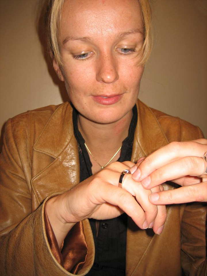 Petra admiring the ring, trying to get used to the idea