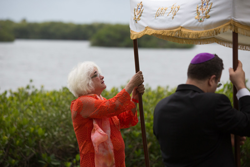 This picture is so funny!  It was really windy and Ellyn was trying her hardest not to let the chuppah fly away.