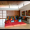 I love the colorful array of cushions, so tastefully done!