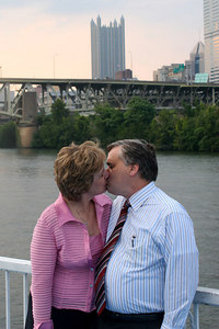 Bob and Joyce sneaking a kiss at the reception - Pittsburgh, PA ... September 9, 2006 ... Photo by Rob Page Jr.