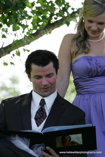 The groom checking out his gift from his bride....Boudoir Album!