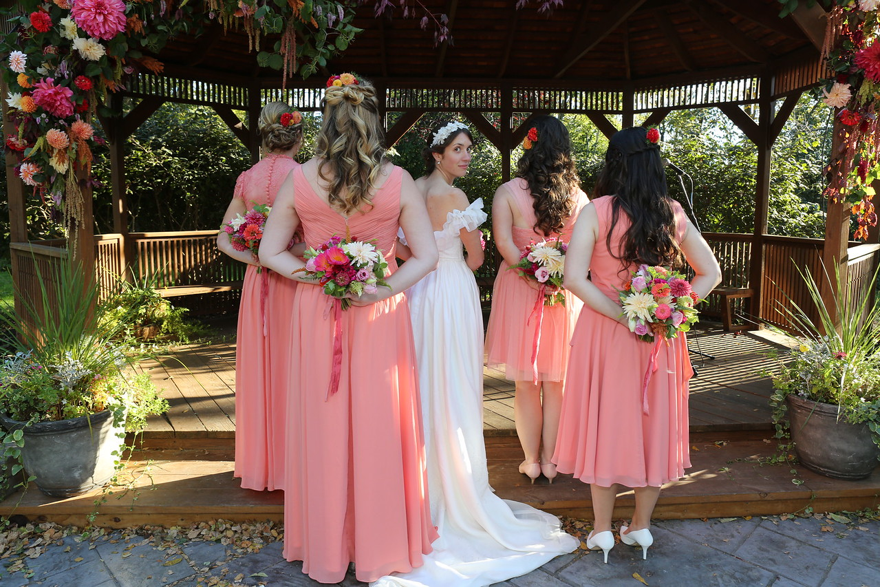 Bridal Party highlighting flowers in hand & hair