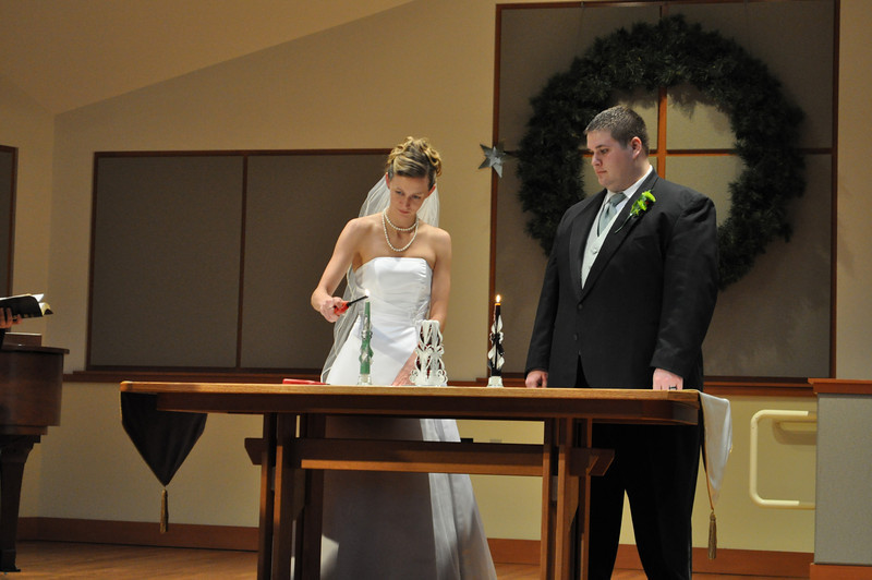 Lighting their candles.