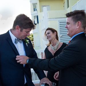 """David checks out the groom's suit: """"Nice material."""""""