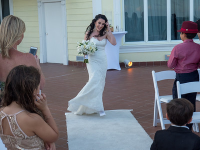 The beautiful bride comes down the aisle.