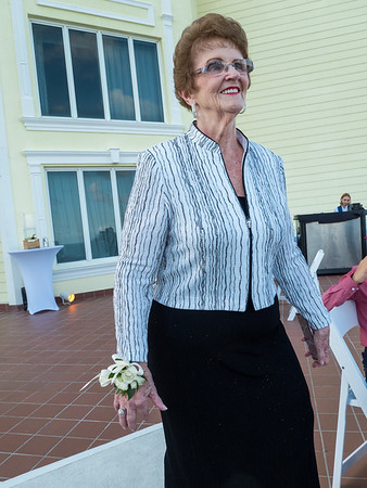 The mother of the groom, Barbara walks down the aisle.