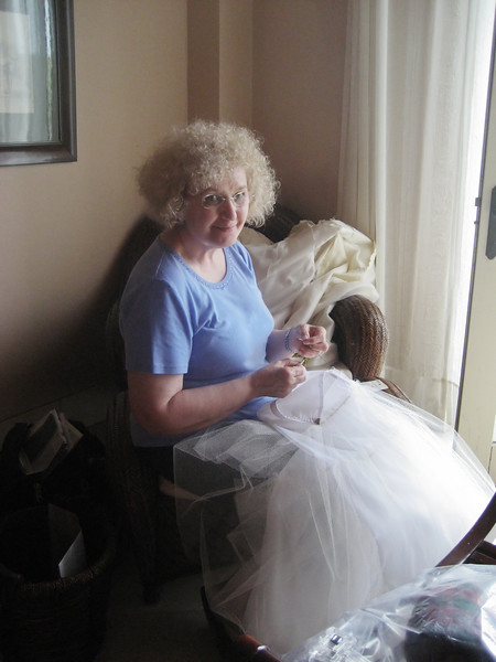 mom hard at work making the beautiful dress