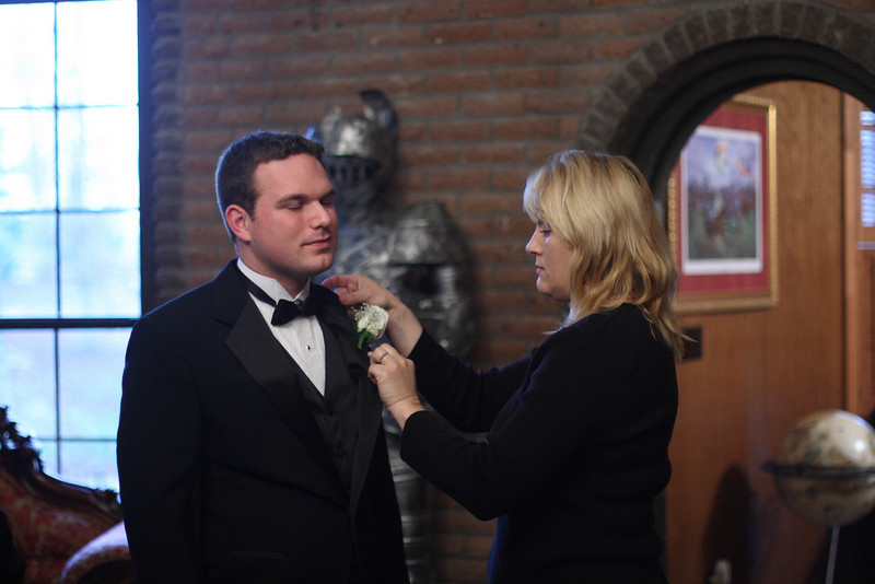 Mitch savors his newly placed boutonnière.