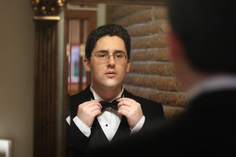 Jude adjusts his bow tie.