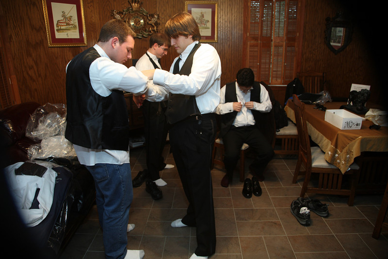 The groom and groomsmen wore tuxedos, which involved a fascinating process of learning how to do so.