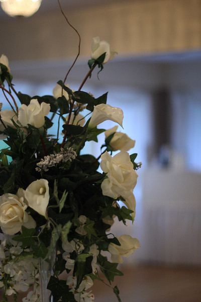 This is a closer view of one table's floral centerpiece.