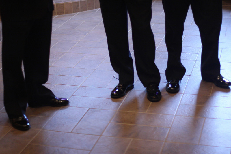 The men of the wedding party wore formal shoes.