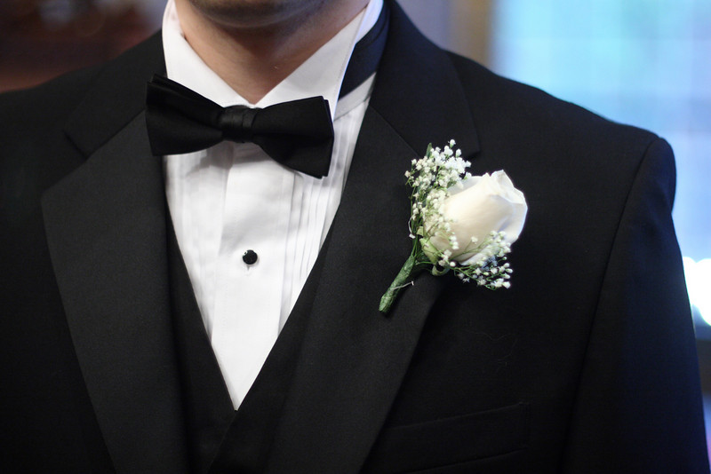 Jude's boutonnière adds to his style.