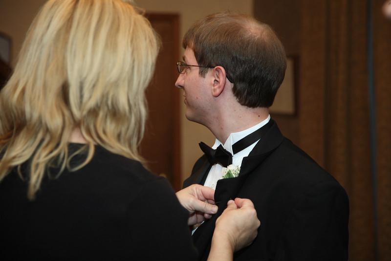 Greg receives his boutonnière.