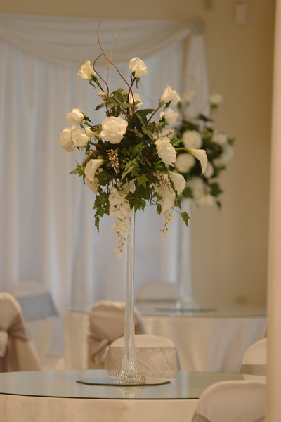 This is Louisiana Castle's standard centerpiece, a white floral arrangement.