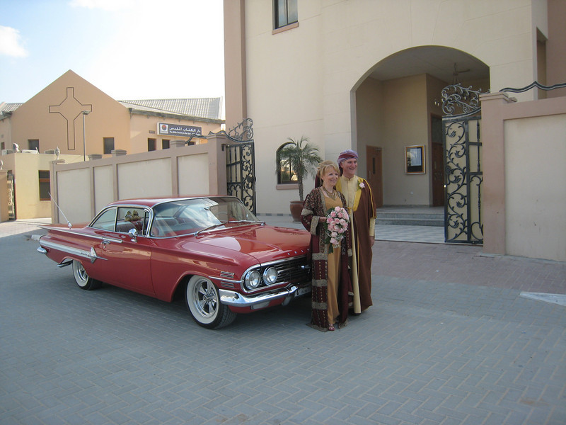 Outside the church.  Our wedding car is a '58 Chevy Impala which our wonderful neighbour Sam loaned to us for the day, including the services of his driver.  Shukran gazelan Sam!