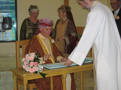Colin signing the register.