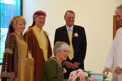 Cathy signing the register, best man John Guest and Rev Steven Wright.
