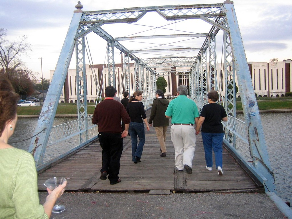 Crossing the footbridge on Bayou St. John with Gretchen's parents having no idea that Gretchen and David plan to announce that THE WEDDING CEREMONY will take place right then and there on the middle of fhe footbridge.