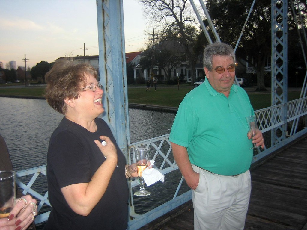 Mom is giggling -  she is  in shock, still.   Dad is, well, happy - can you tell.  No really - he's just thinking, do I need another shot of champagne or not.