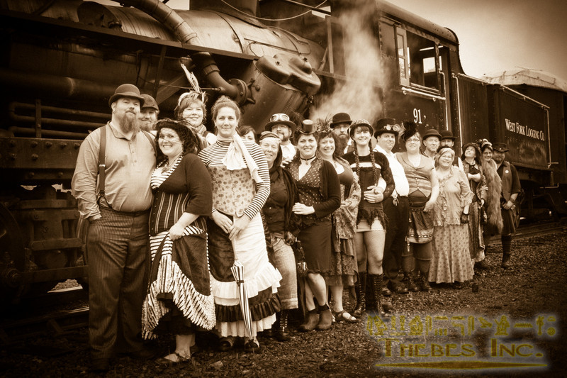 The costumed wedding party poses before Mt. Rainier Scenic Railroad's steam engine
