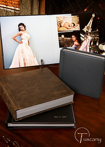 "Custom wedding albums in sizes up to 12""x12"" and 11""x14"" with hinged pages and numerous cover choices."