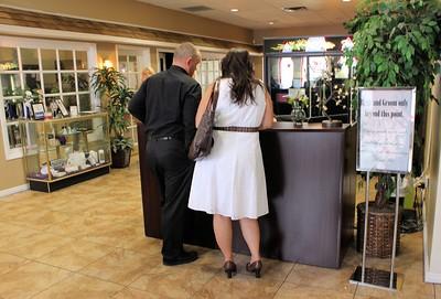 Robert & Claudia making their wedding arrangements.