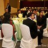 Guests watch the ring ceremony.