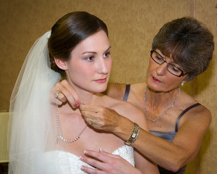 Precious moments - mother and bride in final preparations.