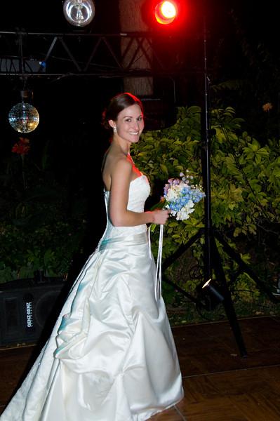 Bouquet Toss under the dance lights.