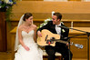 The Ceremony - capturing the surprise as the groom unexpectedly and expertly sings to his bride.