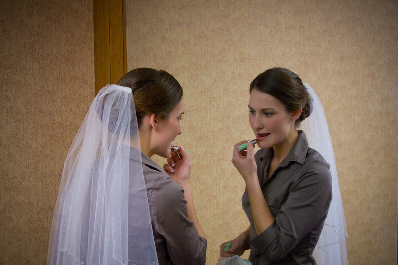 Getting ready - beautiful even before attired in the wedding dress.  The photographer's day is your day - unobtrusively capturing memories - details quickly lost in the blur of the moment.  These are memories to share later with your husband - details he is clueless about all your preparation.