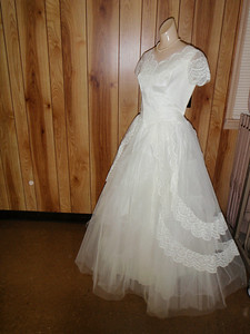 Unbeknownst to Sarah, Jenny retrieved Sarah's wedding dress (wadded up in a plastic bag in a cedar chest) and had it cleaned and restored to the way it looked in 1960!