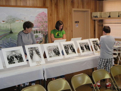Betty, Shelby, and Fuller (Jane's grandkids) check out the final setup of the enlarged wedding day photos.