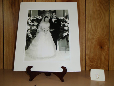 An angel was placed on the mantle with the wedding photo to represent Todd's presence at the party.