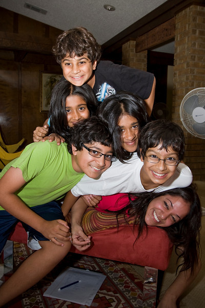 How many kids does it take to squish Avni.  More than are in this picture! so we have to wait for more of the family to arrive to try this again!