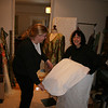 Katie collects her dress from Sandra, seamstress extrarodinare.