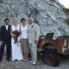 Wedding party at beautiful location off the Columbia River, with a relic of a rusted jeep.