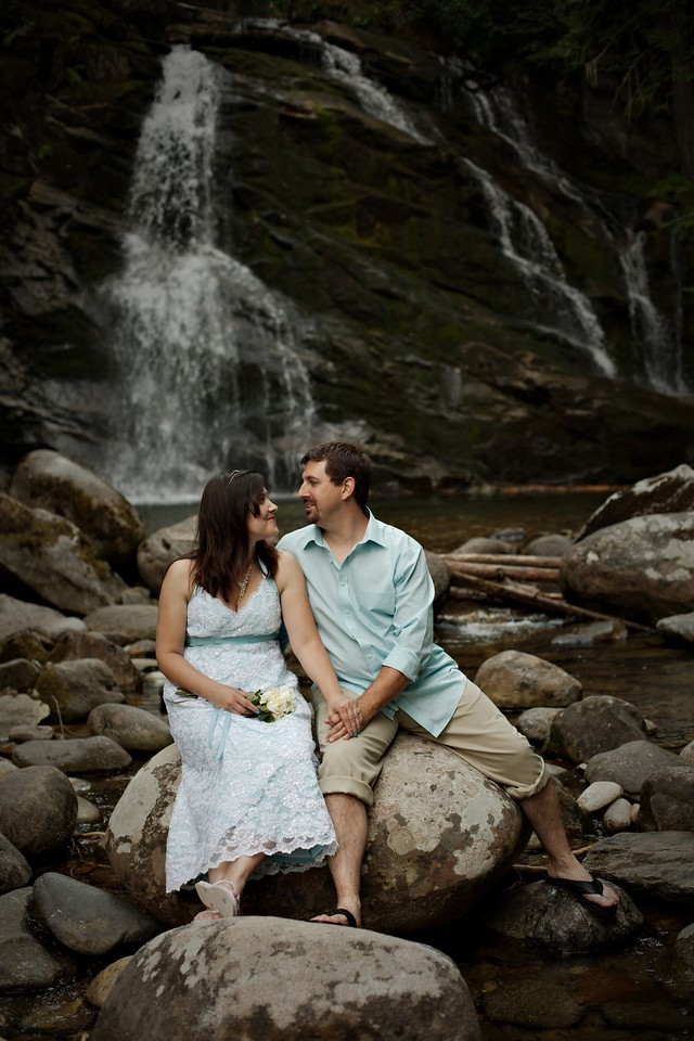 couple shot at the waterfall