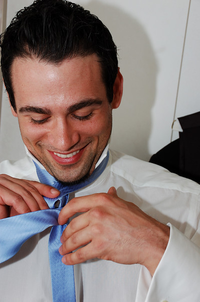 Nick trying to tie his tie