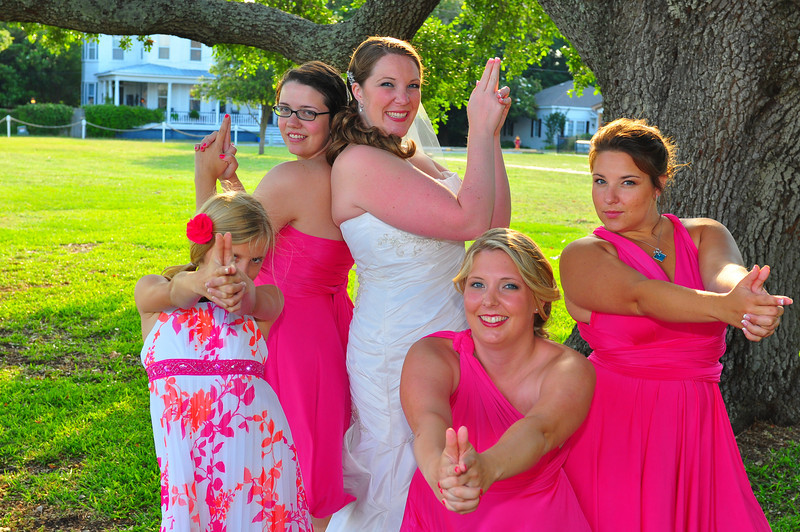 The Southport Community Center in Southport, NC is a great place to get married.   Bryce Lafoon photographs a bridal party doing there best Charlie's Angels pose.