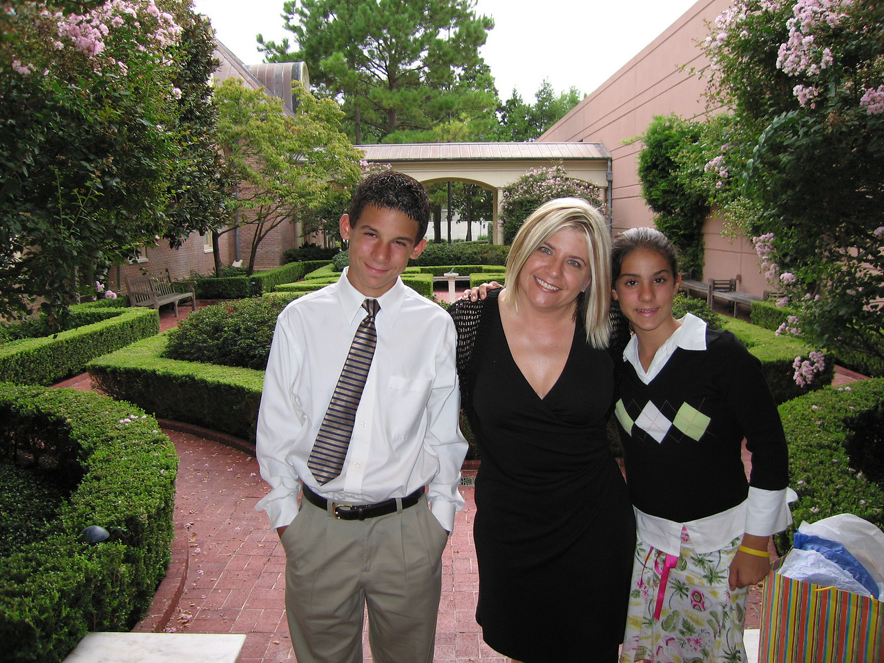 Zac, Kelly and Alex outside the Junior League