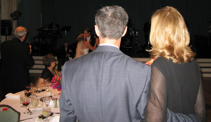 The parents watch the dance