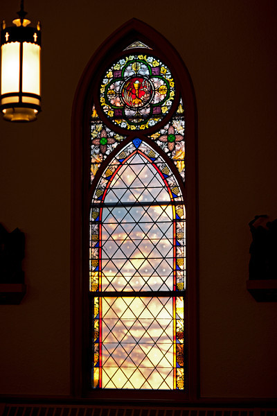 Evening light through a west facing stained glass window at Stacy Plucinski's and Aaron Obispo's wedding rehearsal.