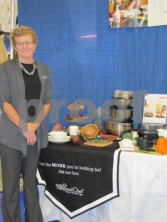 Lauri Beilke of Pampered Chef at her booth at The Messenger's Bridal Show.