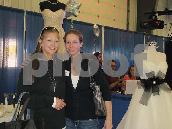 Shari and daughter Kari Ivory, bride-to-be, pose while visiting all the vendor booths at The Messenger's Bridal Show.